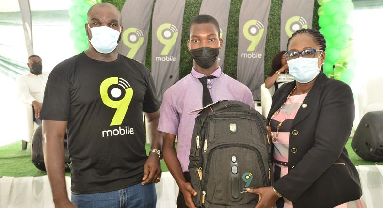 The Manager, Events and Sponsorship, 9mobile, Ufuoma Dogun, one of the students of Akande Dahunsi Senior High School, Paul Okojie and Director of Schools, Education District III, Ministry of Education, Lagos State, Mrs. Osobu Motunrayo (representing the Tutor General, Permanent Secretary, District III), at the 9mobile career counselling programme organized for the students