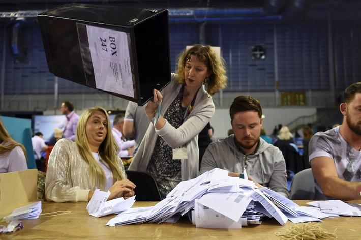 Workers begin counting ballots after polling stations closed in the Referendum on the European Union