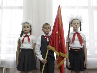 Children attend a ceremony for the inauguration of new members of the Pioneer Organization in Stavro