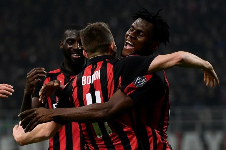 AC Milan's Fabio Borini (C) celebrates with teammates Tiemoue Bakayoko (L) and Franck Kessie after scoring against Inter Milan.