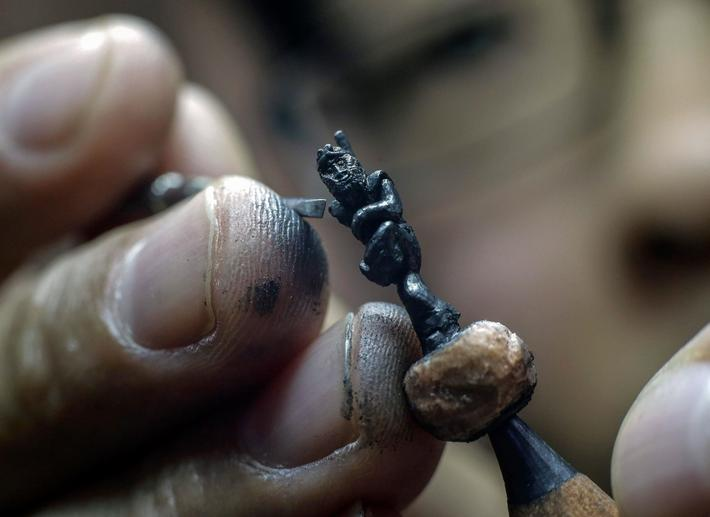 Artist carves Monkey King on the tip of pencil leads for the Chinese Lunar New Year celebrations