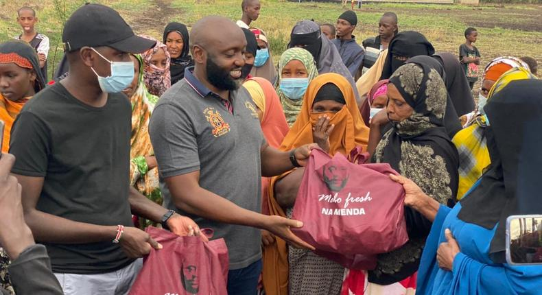 Politician Mwenda Thuranira puts smiles on faces of Isiolo residents with food donation on Mother's Day (Photos)