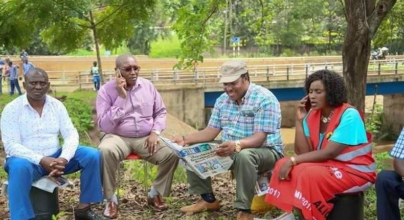 Kabete MP Ferdinand Waititu (reading newspaper), Thika Town MP Alice Nganga (right).