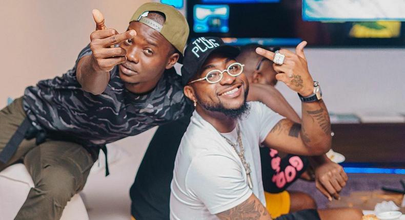 Nigerian music star Davido and Fortune [Instagram/Fortune]
