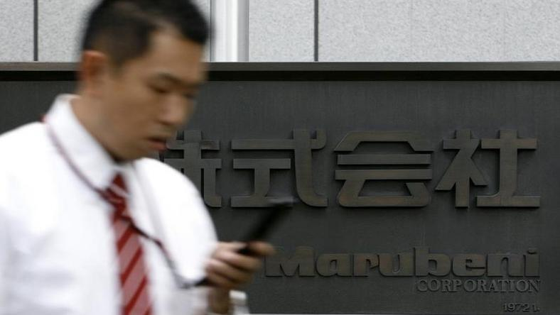 A man walks past a sign of Japanese general trading company Marubeni Corp at the company's head office in Tokyo July 27, 2009. REUTERS/Stringer