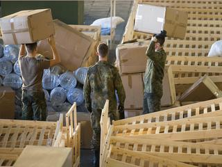 German armed forces Bundeswehr soldiers set up beds for migrants in the hangar of the former Tempelh
