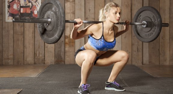 A Barbell squat can help you get closer to your body goals.