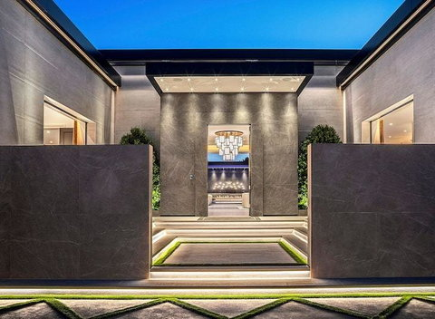 The house is 15,350 square feet and it's billed as a resort compound. It's a single-story, modern compound with a dedicated guardhouse.  [TMZ]