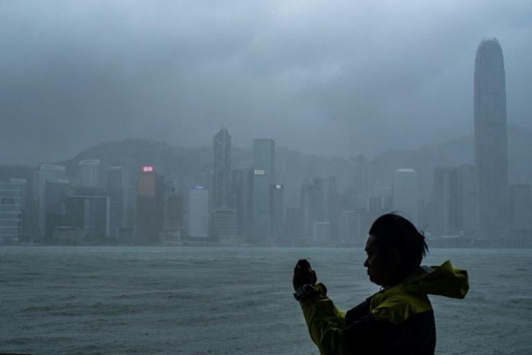 Hong Kong's observatory warned that Mangkhut would pass 100 kilometres south of the city as it raised the storm alert to its highest level