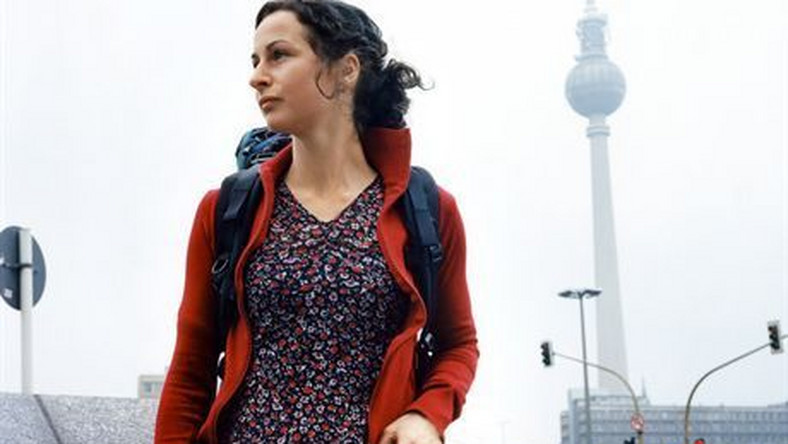 Berlin, Germany --- Young Woman with Backpack in City --- Image by © Ragnar Schmuck/zefa/Corbis