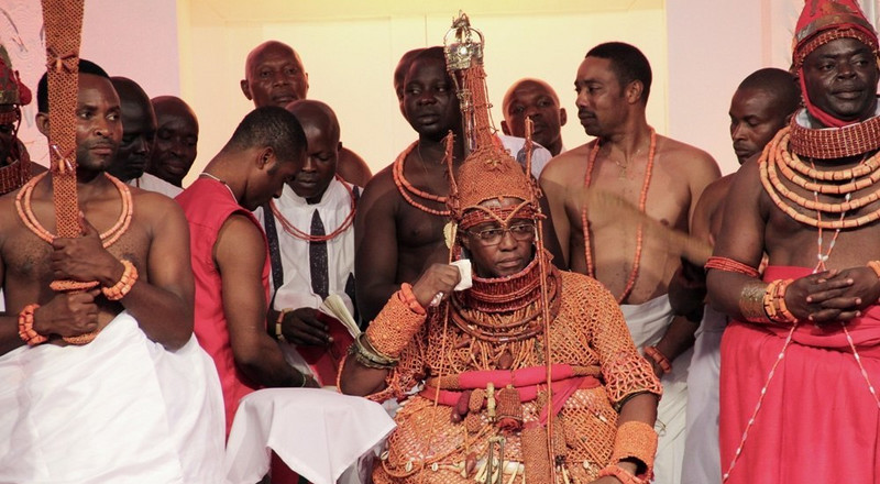 You should not do any of these while visiting the Oba's palace in Benin