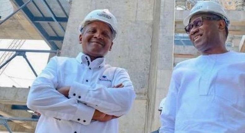 Femi Otedola poses with Africa's richest man, Aliko Dangote (realFemiOtedola)
