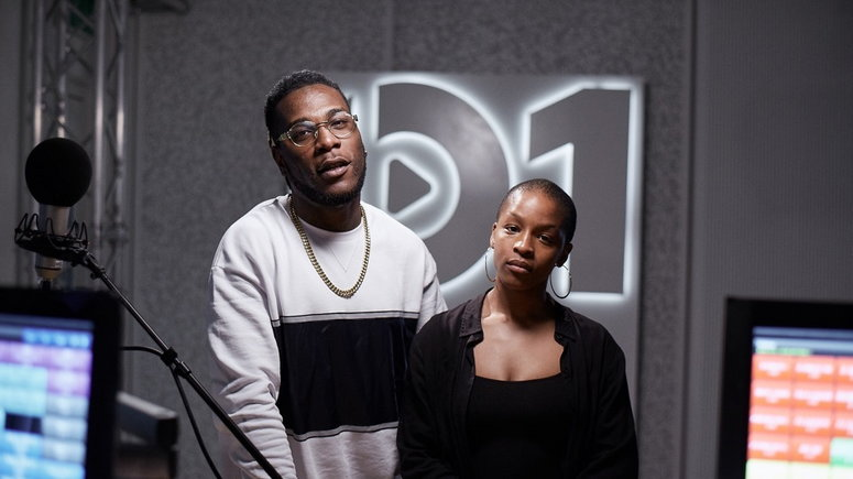 Burna Boy and Julie Adenuga. (iTunes)
