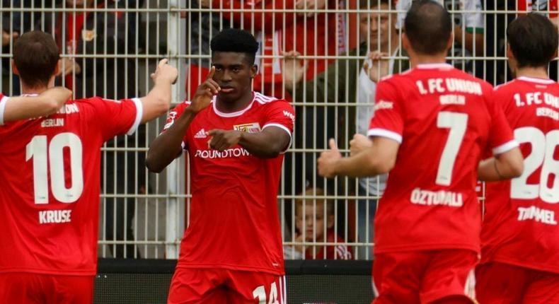 Union Berlin's Nigerian striker Taiwo Awoniyi (C) celebrates his goal on Sunday Creator: Odd ANDERSEN