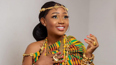 No more skin: Akuapem Poloo sparkles in beautiful bespoken Kente wrap on her birthday