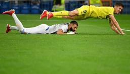 Villarreal defender Juan Foyth and Real Madrid's Karim Benzema battle for the ball during Saturday's game in La Liga. Creator: GABRIEL BOUYS