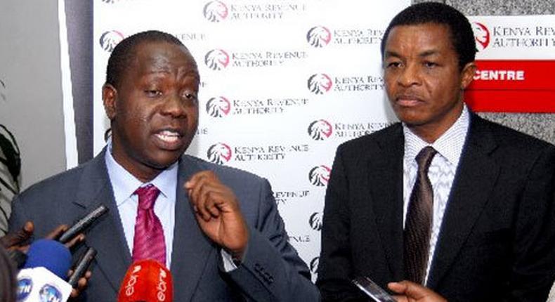 File image of CS Fred Matiangi with KRA Commissioner General John Njiraini