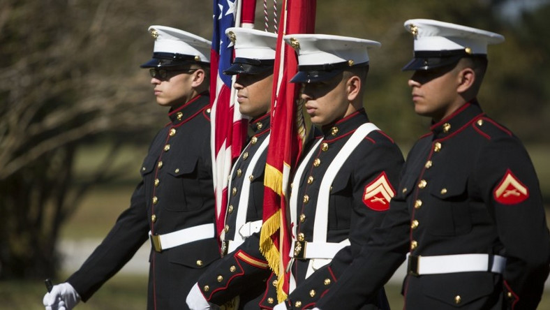 U.S. Marines with the School of Infantry-East Color Guard stand at parade rest during a wreath laying ceremony on the anniversary of the bombing of the Marine Barracks in Beirut, Lebanon on Camp Geiger, N.C., Oct. 23, 2015.