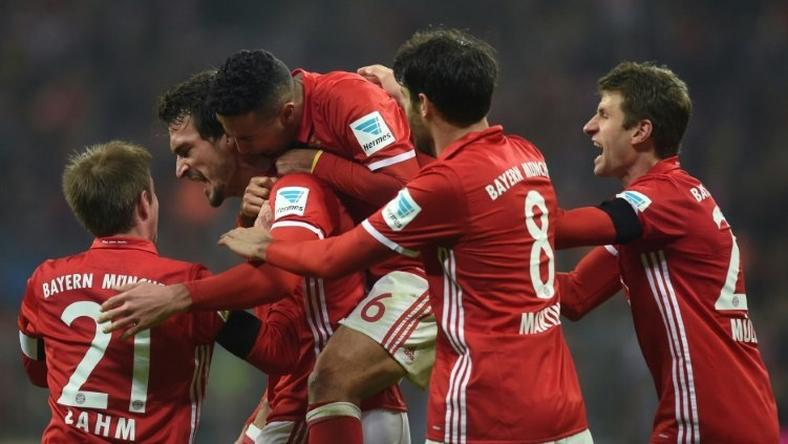 Bayern Munich's defender Mats Hummels (2nd L) celebrates scoring with his teammates during the German first division Bundesliga football match against Bayer 04 Leverkusen November 26, 2016