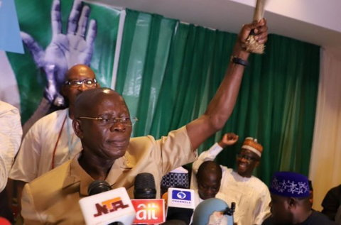 Oshiomhole waves the APC symbolic broom during a party meet (Punch)