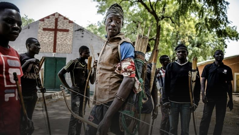 Land of tensions: Hunters armed with bows and arrows gathered in Dasso, central Nigeria, in February pledging to defend farmers in conflict with nomadic herdsmen