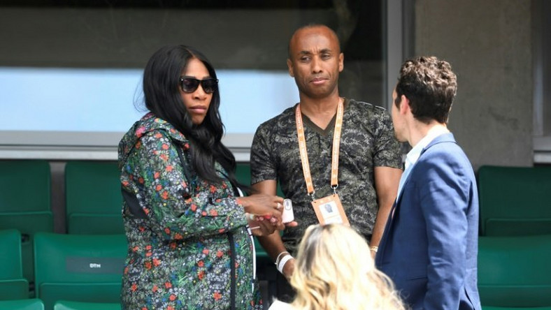 Serena Williams (L) leaves after attending her sister Venus Williams' tennis match against Japan's Kurumi Nara at the French Open