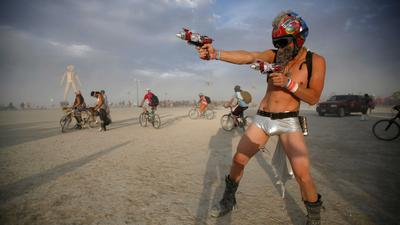 An unofficial Burning Man is happening in the middle of the desert without any medical services, private jets, or professionally serviced bathrooms