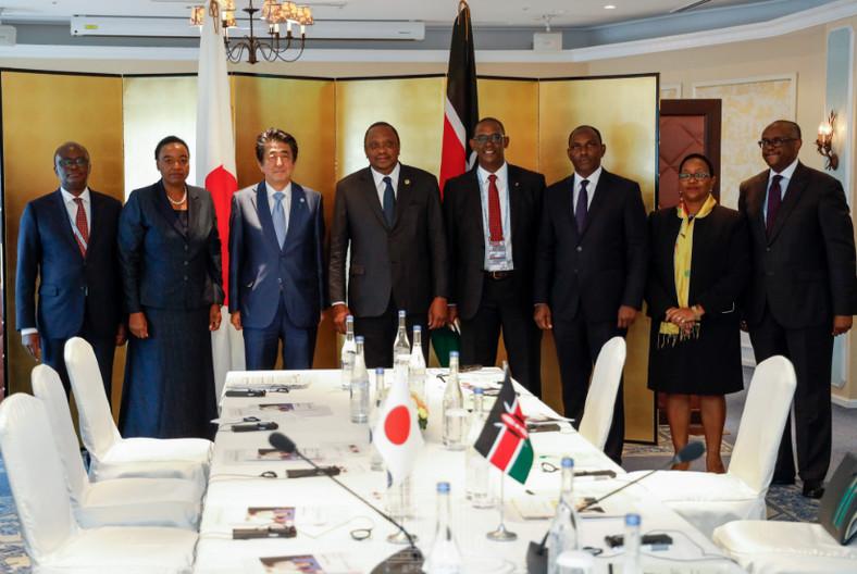 The Kenyan delegation to TICAD conference led by President Uhuru Kenyatta pose with Japan's Prime Minister Shizo Abe.