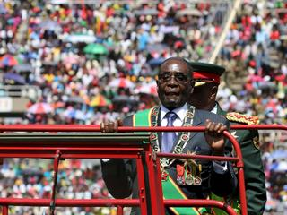 Zimbabwe's President Mugabe arrives to address Zimbabwe's Independence Day celebrations in Harare