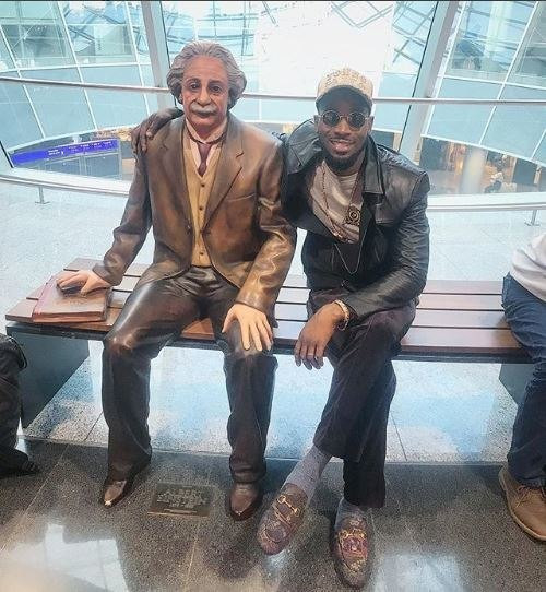 D'banj poses with the statue of Albert Einstein