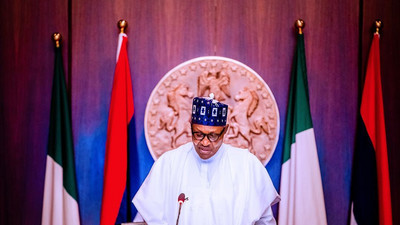 "President Buhari unveils ""Nigeria@60"" logo at Federal Executive Council meeting"