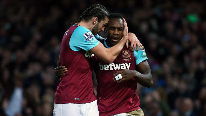 Michail Antonio, Andy Carroll (L)