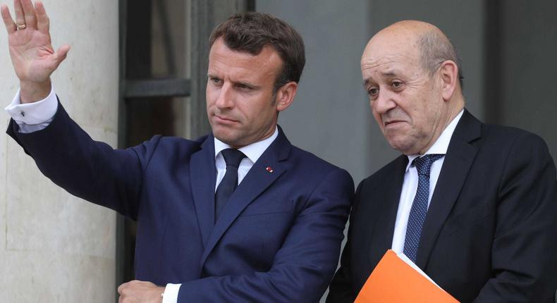 French President Emmanuel Macron and French Foreign Affairs Minister Jean-Yves Le Drian (right).