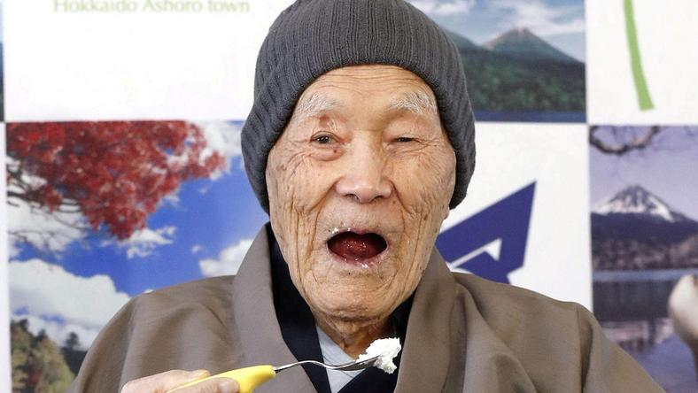 Japanese Masazo Nonaka, who was born 112 years and 259 days ago, eats his favorite cake as he receives a Guinness World Records certificate naming him the world's oldest man during a ceremony in Ashoro, on Japan's northern island of Hokkaido, in this photo taken by Kyodo April 10, 2018. Nonaka died at the age of 113 on January 20, 2019, local media reported. Mandatory credit Kyodo/via REUTERS/File Photo