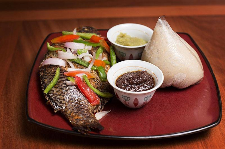 Banku and grilled tilapia with hot pepper