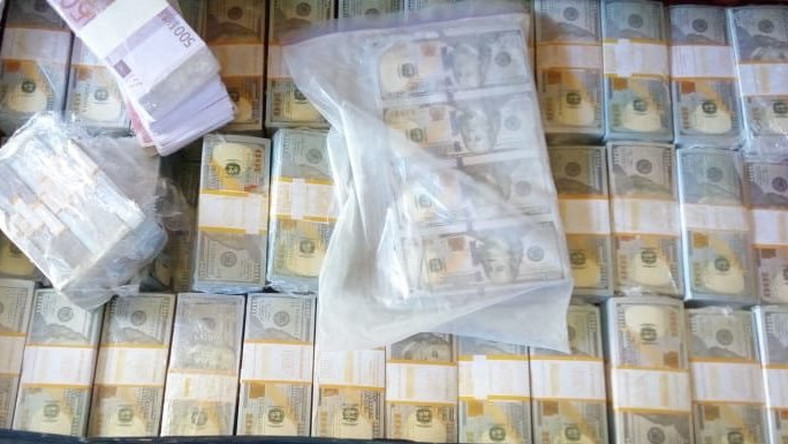 Fake dollars confiscated by DCI in Tuesday morning raid (Twitter)