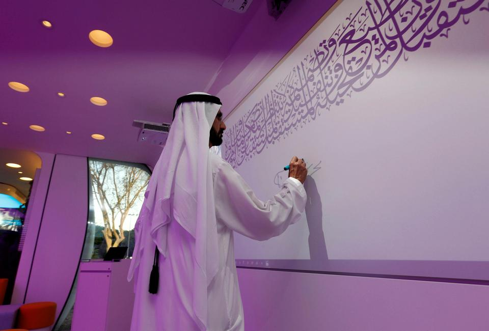 Sheikh Mohammed bin Rashid Al Maktoum signs on the board during the official opening of the world's