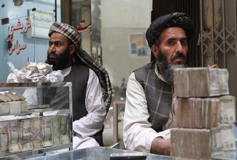Afghan dealers wait for customers at a money market in Kandahar province.