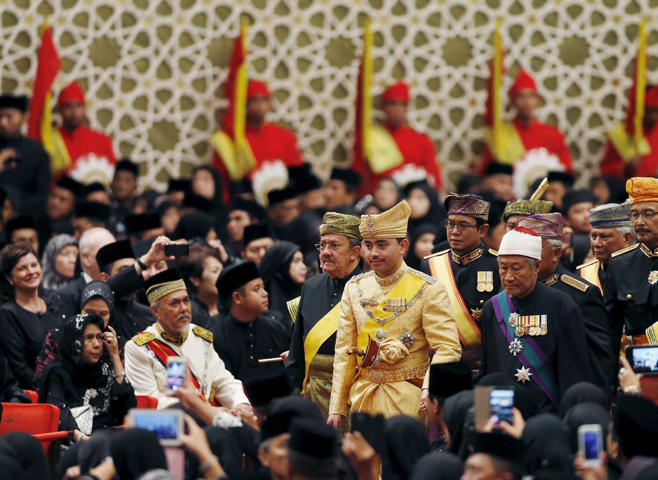 "Prince Abdul Malik arrives at the ""bersanding"" or enthronement ceremony at his wedding to Dayangku Raabi'atul 'Adawiyyah Pengiran Haji Bolkiah in the Nurul Iman Palace in Bandar Seri Begawan"