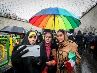 An Iranian woman take selfies during a ceremony to mark the 40th anniversary of the Islamic Revoluti