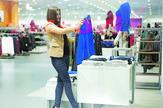 attractive-woman-choosing-cloths-shop-450w-126762170