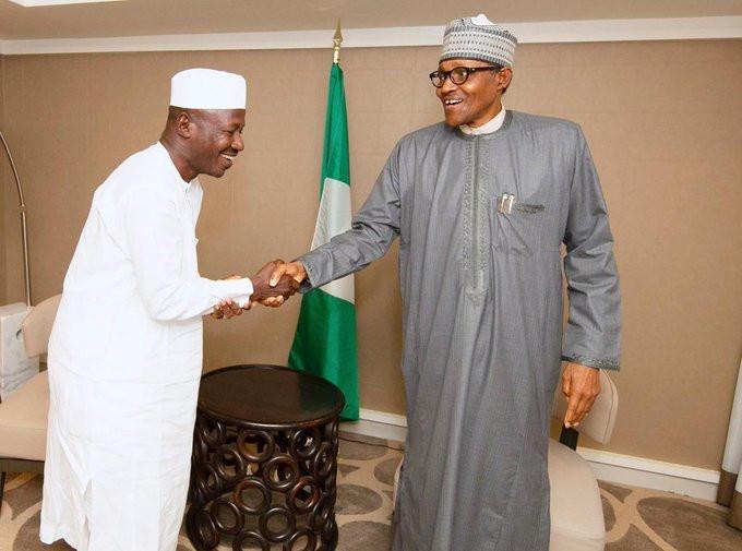 Ibrahim Magu (left) shakes hands with President Muhammadu Buhari (right) [EFCC]