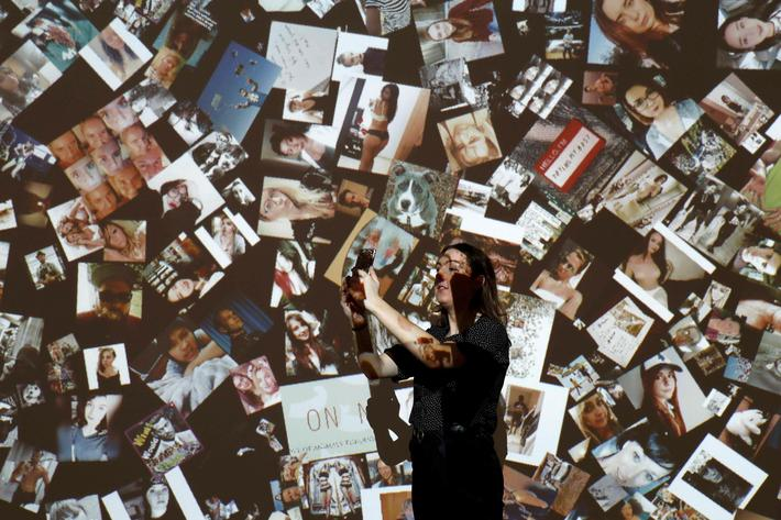 A gallery assistant poses for a photograph during a press day to promote the upcoming exhibition Fr