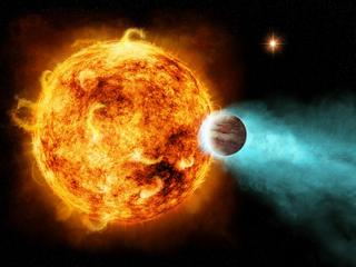 A star with a planet in very close orbit around it, about 880 light years from Earth.