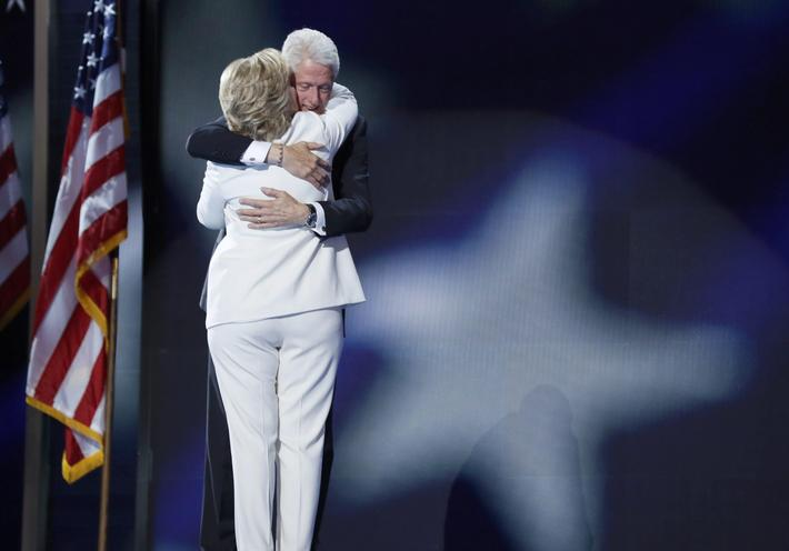 Democratic presidential nominee Hillary Clinton hugs and kisses her husband former president Bill Cl