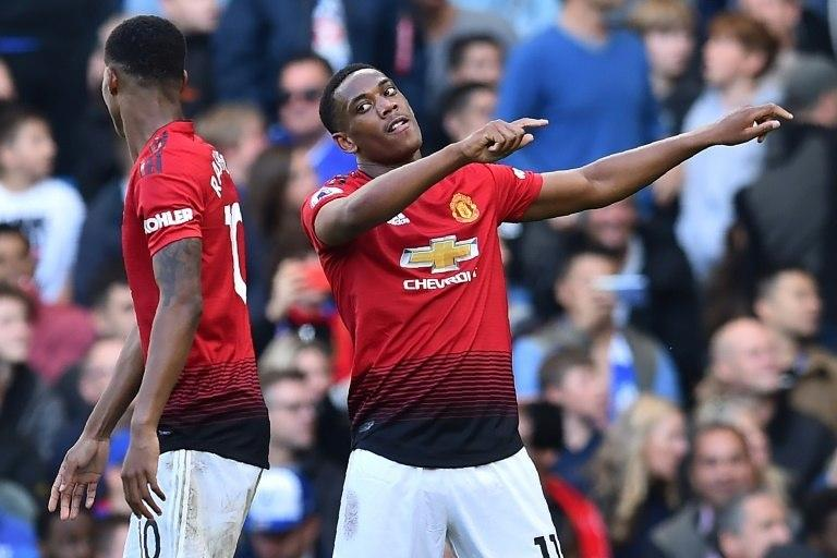 Manchester United forward Anthony Martial (right) celebrates his second goal against Chelsea