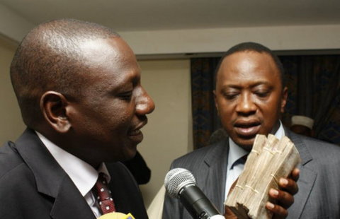 President Uhuru Kenyatta with Deputy President William Ruto captured with wads of cash.