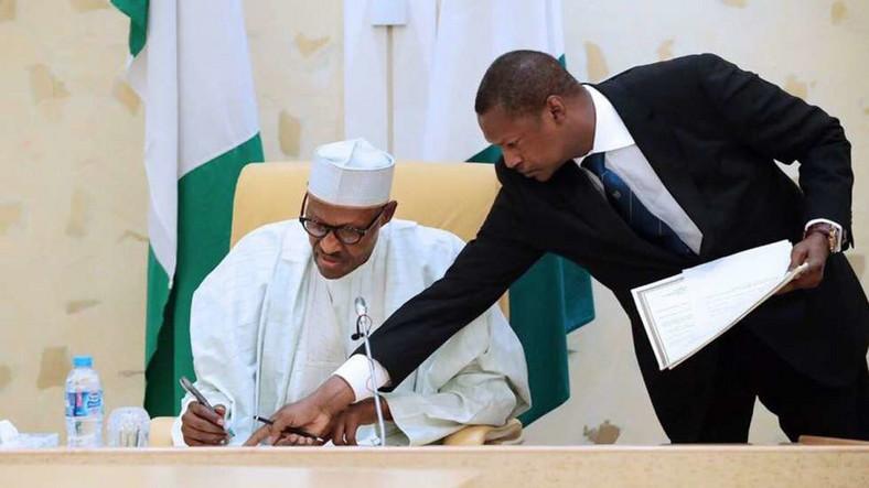 President Muhammadu Buhari (Left) and the Attorney General, Abubakar Malami (Right)