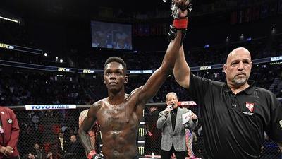 Nigerian-born Israel Adesanya beats Yoel Romero to remain UFC Middleweight champion