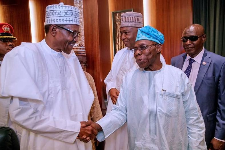 Obasanjo (right) is a major opposition figure against the re-election bid of Buhari (left)